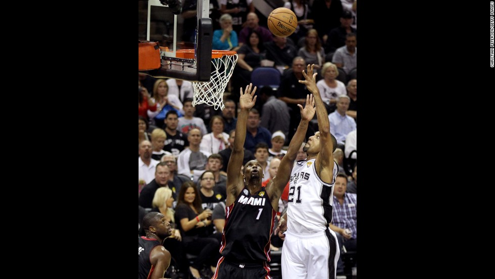 Tim Duncan of the San Antonio Spurs shoots over Chris Bosh in the third quarter.