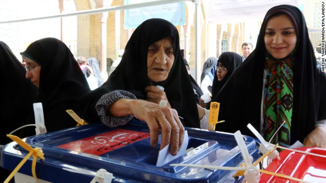 A woman casts her ballot during the Iranian presidential elections in Shahre-Ray, Iran, on Friday, June 14.