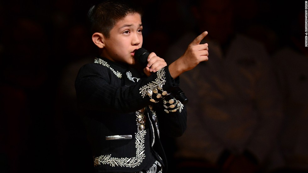 "<strong>June 2013:</strong> 11-year-old Sebastien de la Cruz became a household name after the <a href=""http://www.cnn.com/2013/06/12/us/mexican-american-boy-sings-anthem"">Mexican-American child sang the national anthem</a> in a mariachi outfit before the start of an NBA Finals game. There was a quick backlash, but ""El Charro de oro,"" as he's known, was <a href=""http://www.cnn.com/2013/06/14/us/mexican-american-boy-encore/index.html"">invited back for an encore performance</a>.<br /><br />""For those that said something bad about me, I understand it's your opinion,"" Sebastien said. ""I'm a proud American and live in a free country. It's not hurting me. It's just your opinion."""