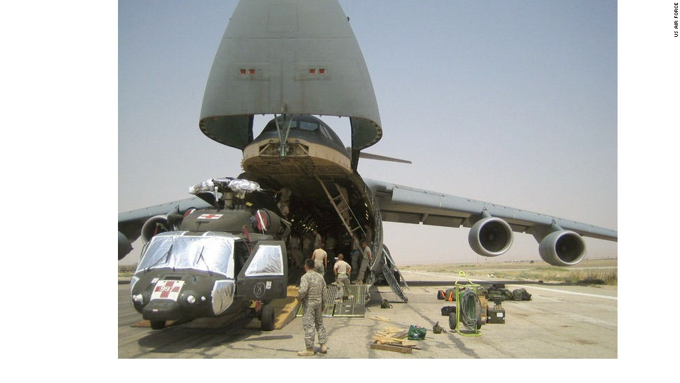 "The C-5, seen here in Afghanistan, moves entire units of fighting forces and their battle machines such as helicopters, trucks and tanks around the world at <a href=""http://www.af.mil/information/factsheets/factsheet.asp?id=84"" target=""_blank"">jet speeds around 518 mph. </a>Its nose opens the full width and height of the cargo bay for quick, easy loading."