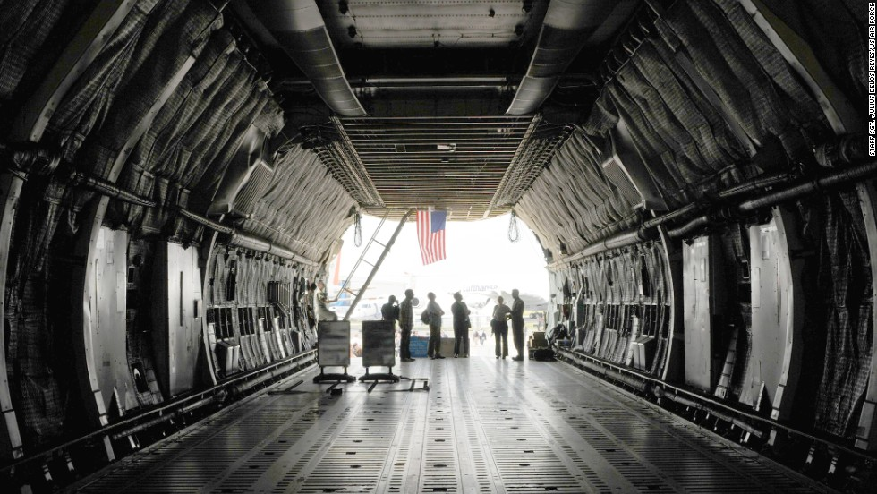 "The C-5's cargo hold reaches 13.5 feet high. Its length <a href=""http://www.af.mil/information/factsheets/factsheet.asp?id=84"" target=""_blank"">stretches 143 feet, nine inches</a> -- about 23 feet longer than the length of <a href=""http://airandspace.si.edu/exhibitions/gal100/wright1903.html"" target=""_blank"">the first flight by the Wright brothers</a>."