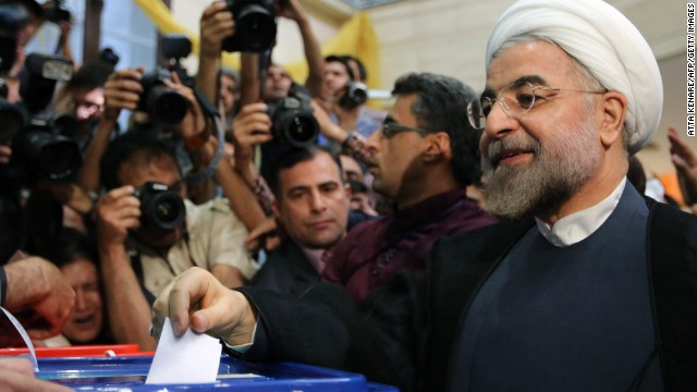 Iranian moderate presidential candidate, Hassan Rowhani casts his vote at a polling station in Tehran on June 14, 2013.