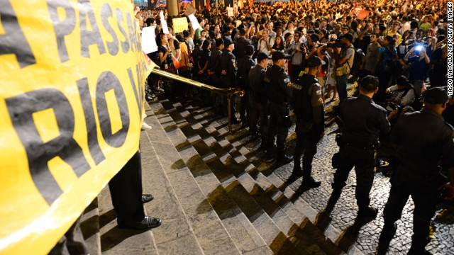Brazilian students protest against the rise in public transport fares in downtown Rio de Janeiro, Brazil, on June 13, 2013.