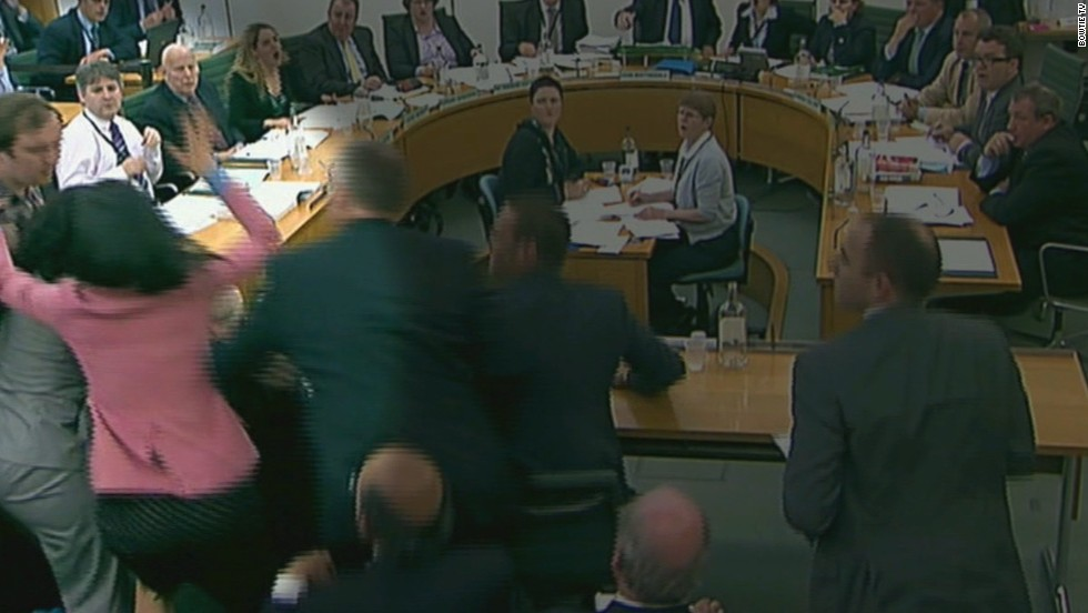 Deng made headlines in 2011 when she stopped a protester from hitting Murdoch with a shaving cream pie during a UK parliamentary hearing concerning allegations of phone hacking by his company. Above, Deng stops activist and comedian Johnnie Marbles from throwing the pie in Murdoch's face on July 19, 2011, in this still taken from video.