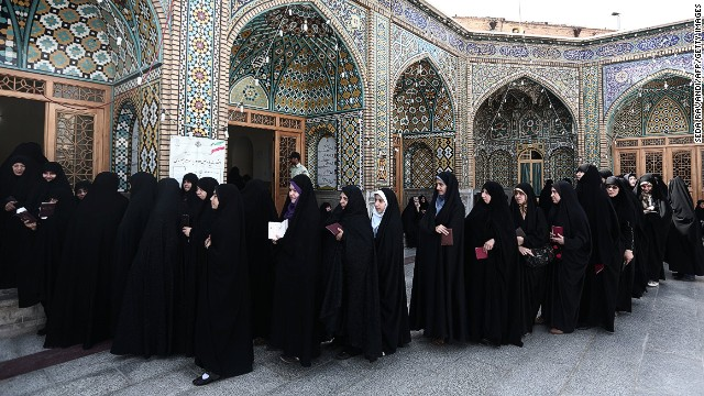 Iranian women wait in a queue to vote at a polling station at the Massoumeh shrine in the holy city of Qom, 130 kms south of Tehran, during presidential elections in the Islamic republic on June 14, 2013.