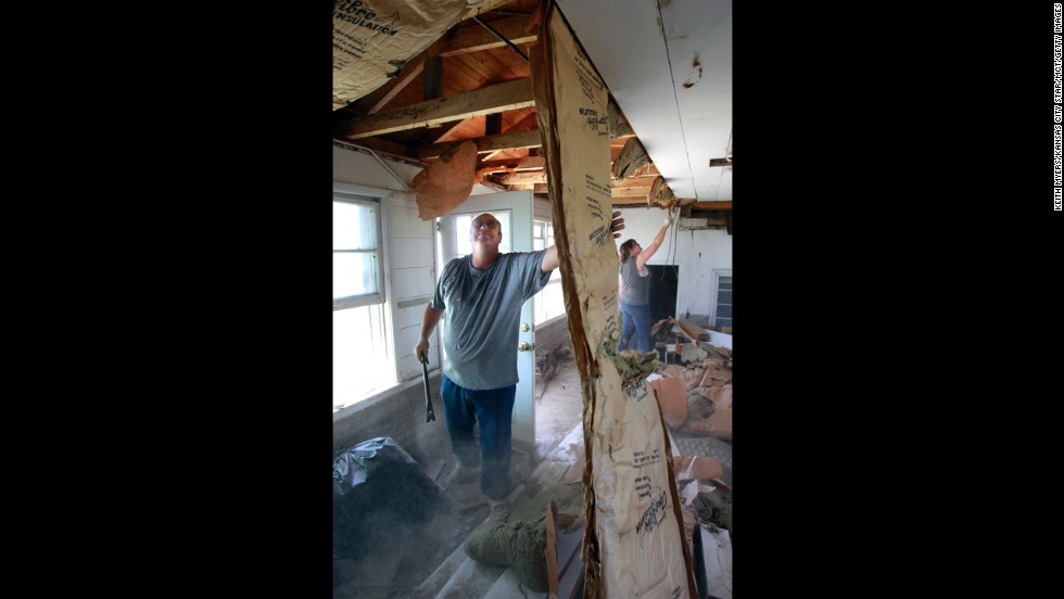 Delbert Wilcox, left, and his granddaughter Samantha Vermillion work to salvage lumber and wiring from the home of Ken Knox on May 30 in northern Platte County, Missouri. Severe weather from the Plains to the Northeast in late April and late May 2012 caused an estimated $3.3 billion and $2.3 billion in losses, respectively.