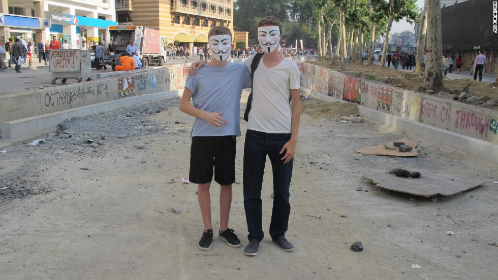 16-year-old twin brothers, Remi and Dilan (pictured right), holding spray cans and wearing the Guy Fawkes masks often used by Occupy protesters.