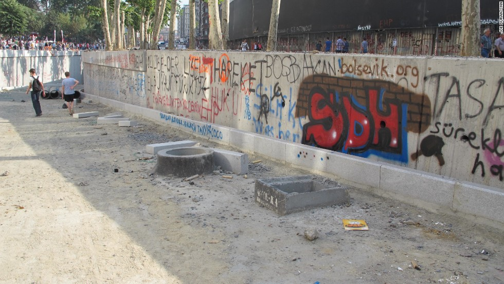 The two high school students walk down into a tunnel underneath Taksim Square after tagging walls nearby with graffiti.