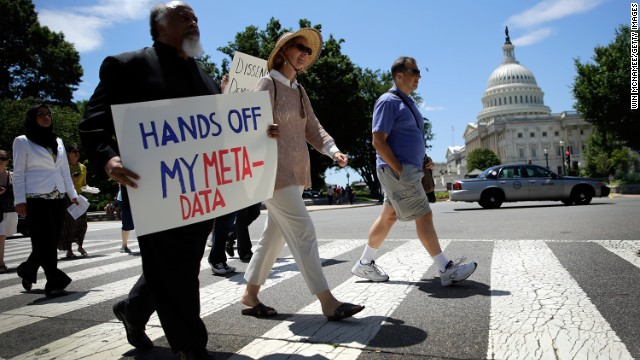 Protesters march outside the U.S. Capitol against the NSA's secret Web surveillance program last month.