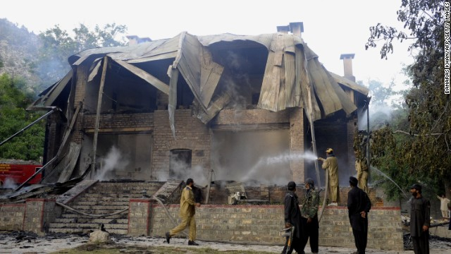 Pakistani firefighters extinguish a blaze which gutted a historical building in Ziarat, southeast of Quetta, on June 15, 2013.