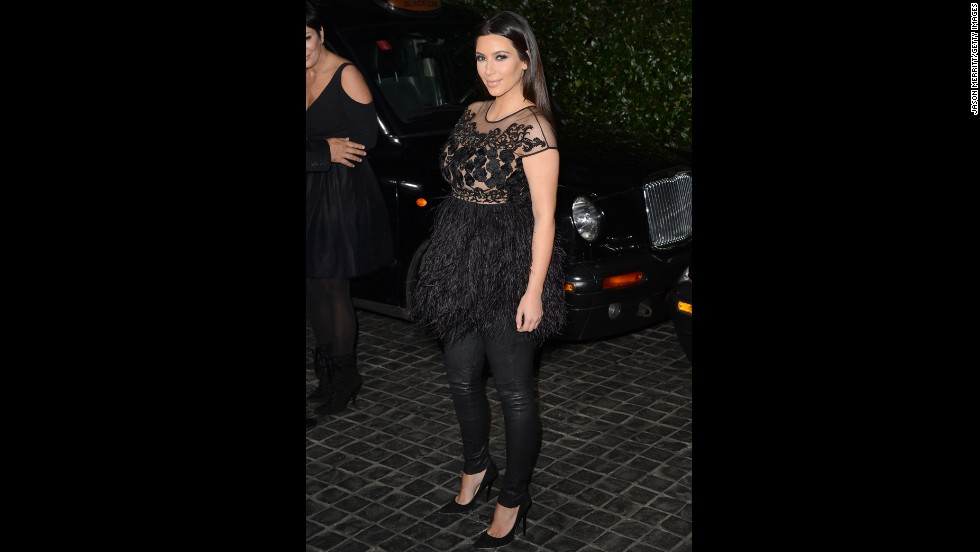 Kim Kardashian sports a feathery frock in February.