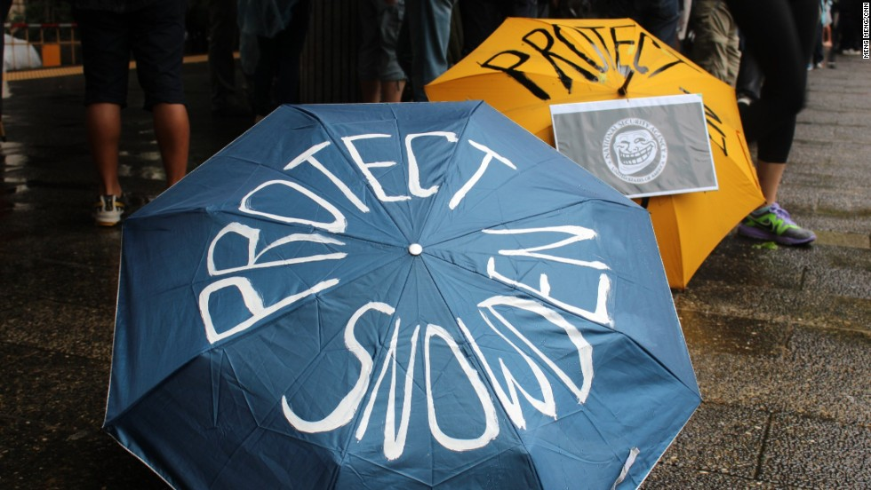 The rain led protesters determined to show their support to prepare laminated placards and umbrellas painted with slogans.