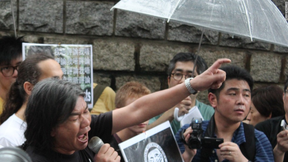 "Hong Kong legislator ""Long Hair"" spoke to the crowd at the second rallying point outside the U.S. consulate."