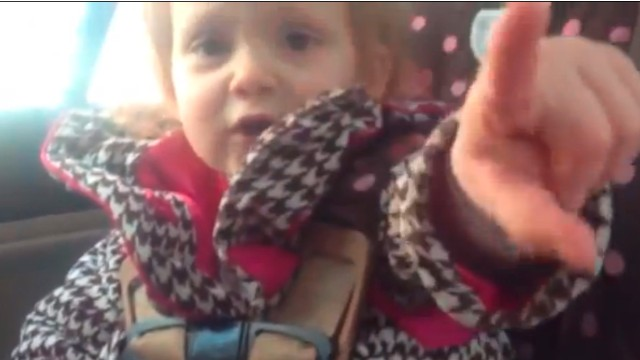 girl has her car seat situation under control