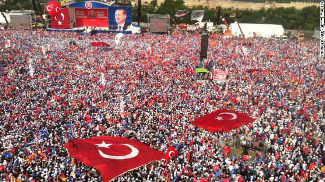 Tens of thousands attend a rally where Turkish Prim Minister Recep Tayyip Erdogan speak at the t the Kazlicesma meeting area in Istanbul on Sunday June 16, a day after he ordered a crackdown on anti-governement protesters at Gezi Park.