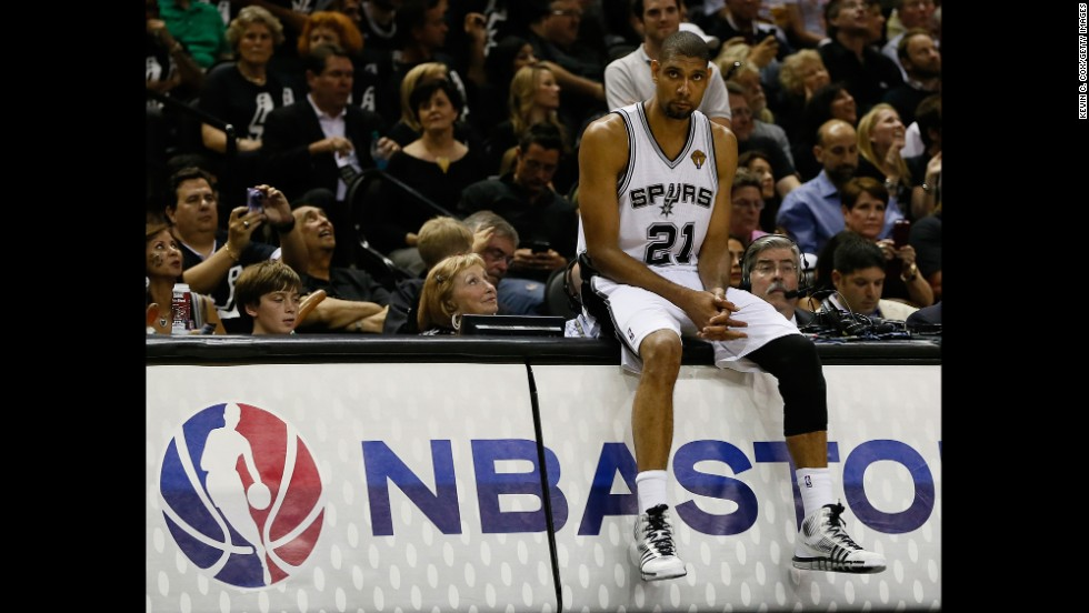 Tim Duncan of the San Antonio Spurs sits on the scorer's table.