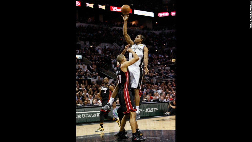 Kawhi Leonard of the San Antonio Spurs shoots over Shane Battier of the Miami Heat in the first half.