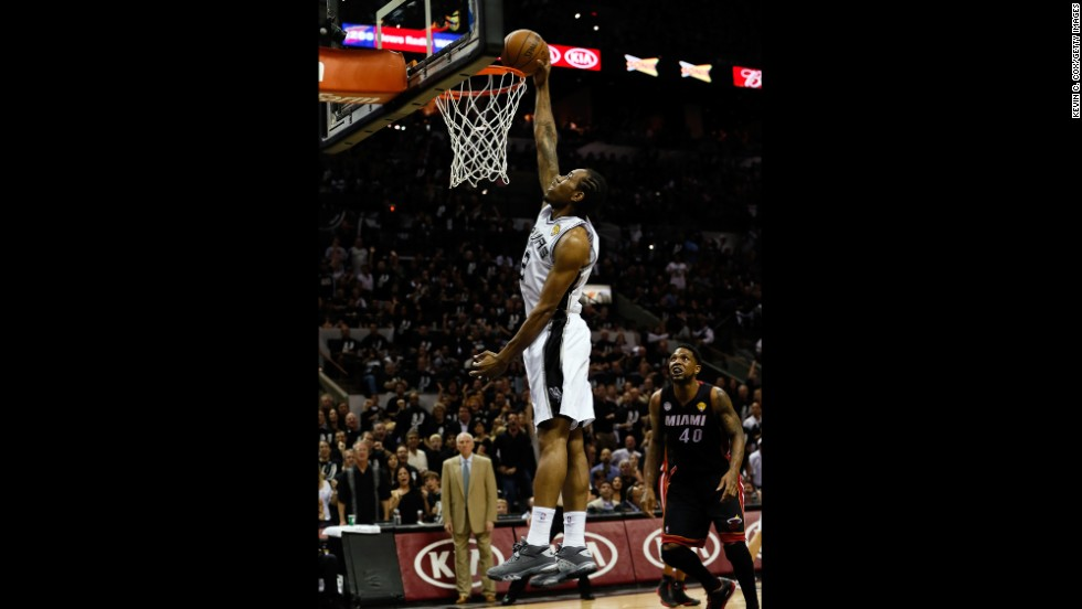 Kawhi Leonard of the San Antonio Spurs dunks.