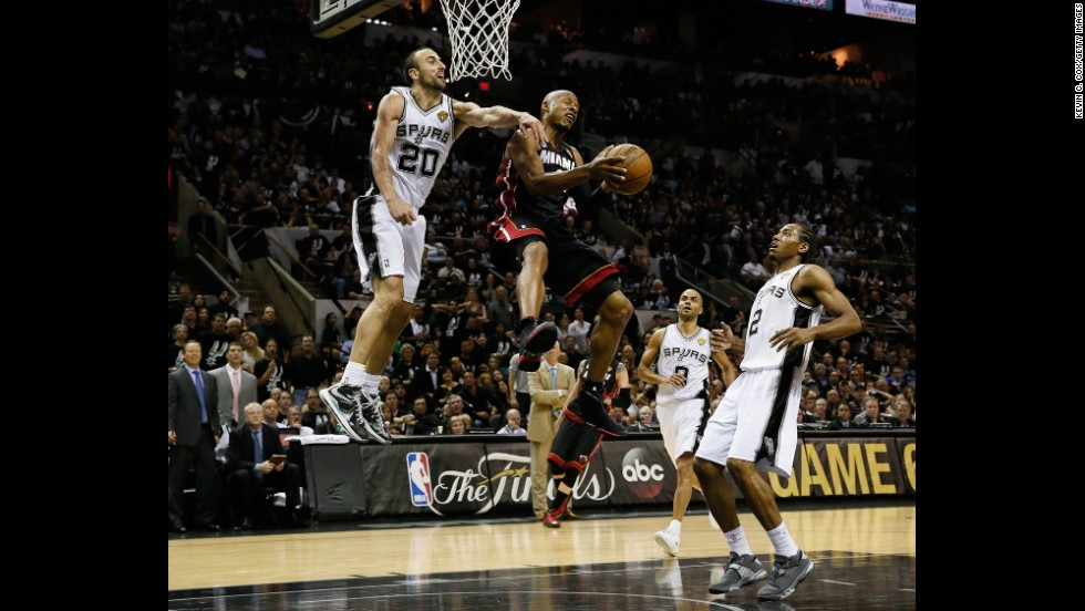 Ray Allen of the Miami Heat goes up for a shot against Manu Ginobili of the San Antonio Spurs.