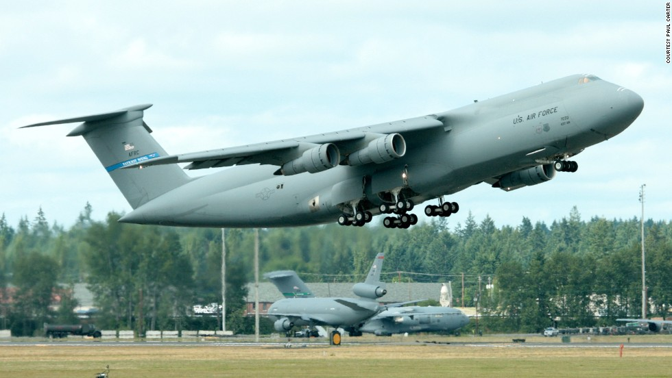 "A C-5B departs Massachusetts' Westover Air Reserve Base in this 2007 <a href=""http://www.flickr.com/photos/planephotoman/"" target=""_blank"">photo snapped by Paul Carter</a>."