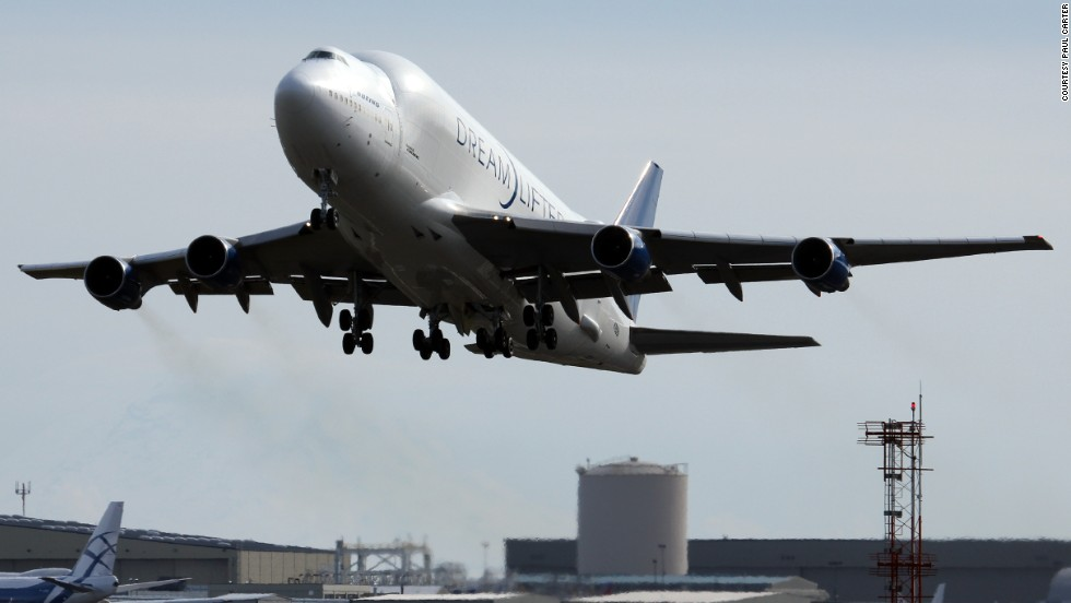 "A modified 747, the Dreamlifter was developed by Boeing to ferry giant aircraft assemblies for the 787 Dreamliner. <a href=""http://www.flickr.com/photos/planephotoman/"" target=""_blank"">Photographer Paul Carter </a>caught it during takeoff from Paine Field in Everett, Washington."