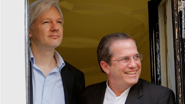 Ecuadurian Foreign Minister Ricardo Patino (R) and Wikileaks founder Julian Assange (L) appear at the window of the Ecuadorian embassy in central London on June 16, 2013 where Assange has spent almost a year after seeking political asylum in a bid to avoid extradition to Sweden for questioning over alleged sex crimes. Patino was expected on June 16 to hold a meeting with Julian Assange in the Ecuadorian embassy during a visit to Britain as the one year anniversary of the founder of the whistleblowing website's stay in the embassy approaches.