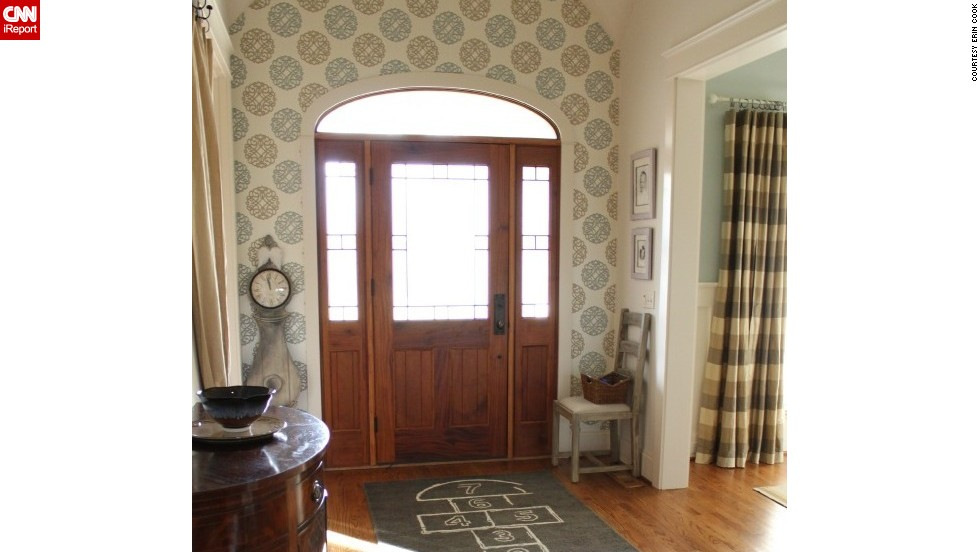 "An open floor plan and two adjacent formal rooms could have overwhelmed <a href=""http://ireport.cnn.com/docs/DOC-988273"">Erin Cook</a>'s foyer in Charlotte, North Carolina, but she choose whimsical wallpaper and a hopscotch rug for a stand-out look."