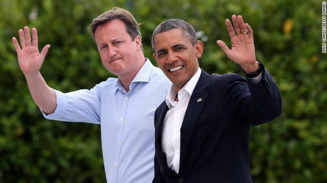 Britain's Prime Minister David Cameron (L) and US President Barack Obama (R) wave as they arrive at the G8 venue of Lough Erne on June 17, 2013 in Enniskillen, Northern Ireland. The two day G8 summit, hosted by UK Prime Minister David Cameron, is being held in Northern Ireland for the first time. Leaders from the G8 nations have gathered to discuss numerous topics with the situation in Syria expected to dominate the talks.