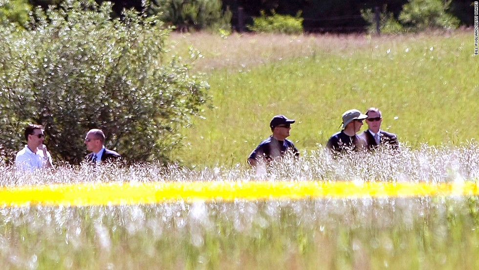 "FBI agents search a field for Hoffa's remains on Monday, June 17, 2013, in Oakland Township, Michigan, outside Detroit. Alleged mobster Tony Zerilli tipped off the police, and a source close to the case said the information provided was ""highly credible."""
