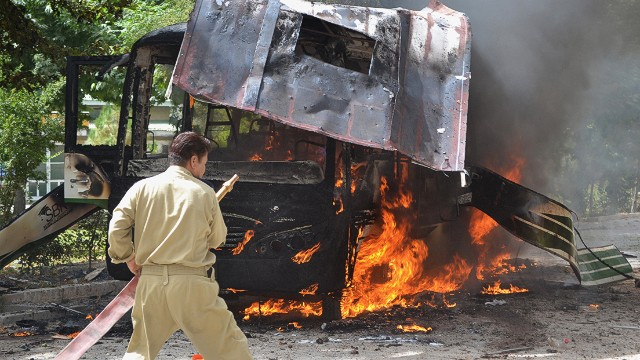Pakistani fire fighters extinguish a burning university bus after a bomb blast in Quetta, the capital of Baluchistan province, on June 15, 2013. At least 23 people were killed after militants blew up a bus carrying female students in Pakistan's troubled southwest and later targeted the hospital treating survivors, as a gun battle with insurgents continued, officials said. AFP PHOTO/ Banaras KHANBANARAS KHAN/AFP/Getty Images