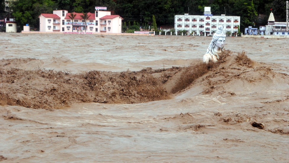 Water flows over a Hindu statue during heavy monsoon rains in Rishikesh town in the state of Uttrakhand on June 17.