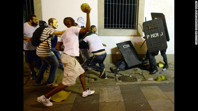 Protesters clash with riot police in downtown Rio de Janeiro on June 17.