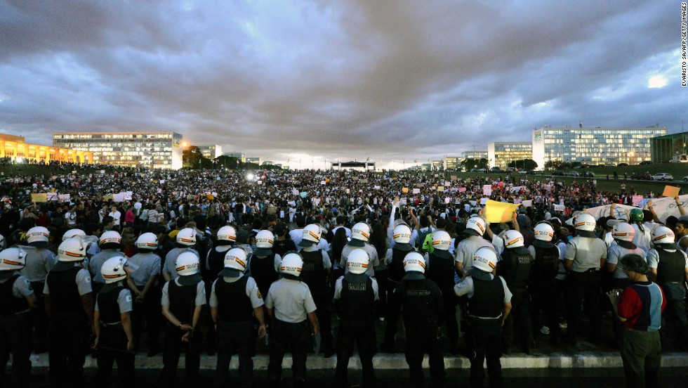 Thousands stand in the gardens of the National Congress in Brasilia during a protest on June 17.