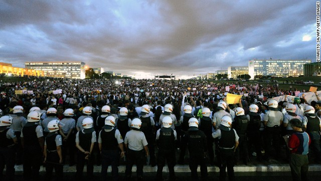 Thousands stand in the gardens of the National Congress in Brasilia, during a protest on June 17.