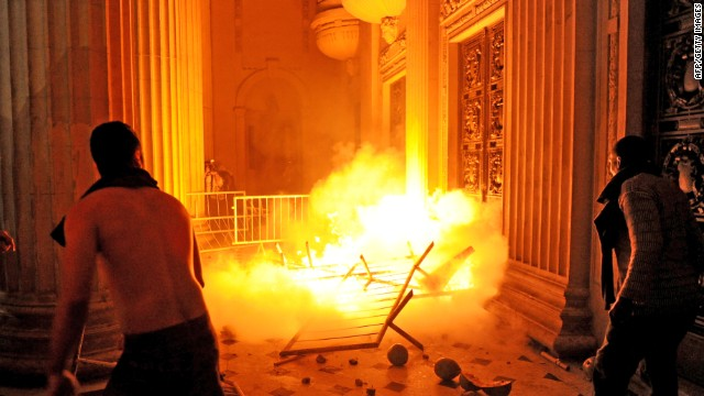 Demonstrators attempt to take Rio de Janeiro's Legislative Assembly (ALERJ) building-- during a protest in Rio de Janeiro, on June 17, 2013.