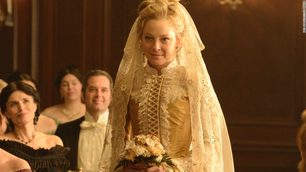 """""""When a woman from 1865 is dressed, she has twice as many garments on as you and I wear in a day,"""" White said. Yards and yards of silk dupioni went into the pleating at the bottom of this gown alone. Fun fact: Her veil is actually an old lace curtain."""