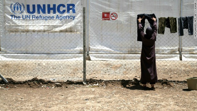 A woman uses a fence at the Domiz refugee camp near Kohuk, Iraq to dry laundry on May 29.