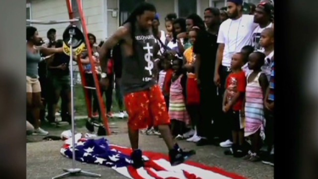 Lil' Wayne steps on flag in video shoot