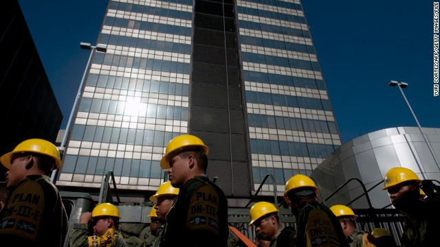 Mexican soldiers arrive at the headquarters of Mexican oil giant Pemex, following an explosion in February.