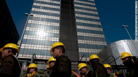 Mexican soldiers arrive at the headquarters of the state-owned Mexican oil giant Pemex, following a blast on the eve, in Mexico City on February 01, 2013. An explosion rocked the skyscraper, leaving up to 32 dead and 121 injured. Hundreds of firefighters, police and soldiers toiled through the night after the blast ripped through an annex of the 54-floor tower leaving concrete, computers and office furniture strewn on the ground. AFP PHOTO/YURI CORTEZ (Photo credit should read YURI CORTEZ/AFP/Getty Images)