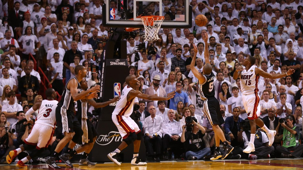 Tony Parker of the San Antonio Spurs makes a basket over Mario Chalmers of the Miami Heat near the end of the fourth quarter.