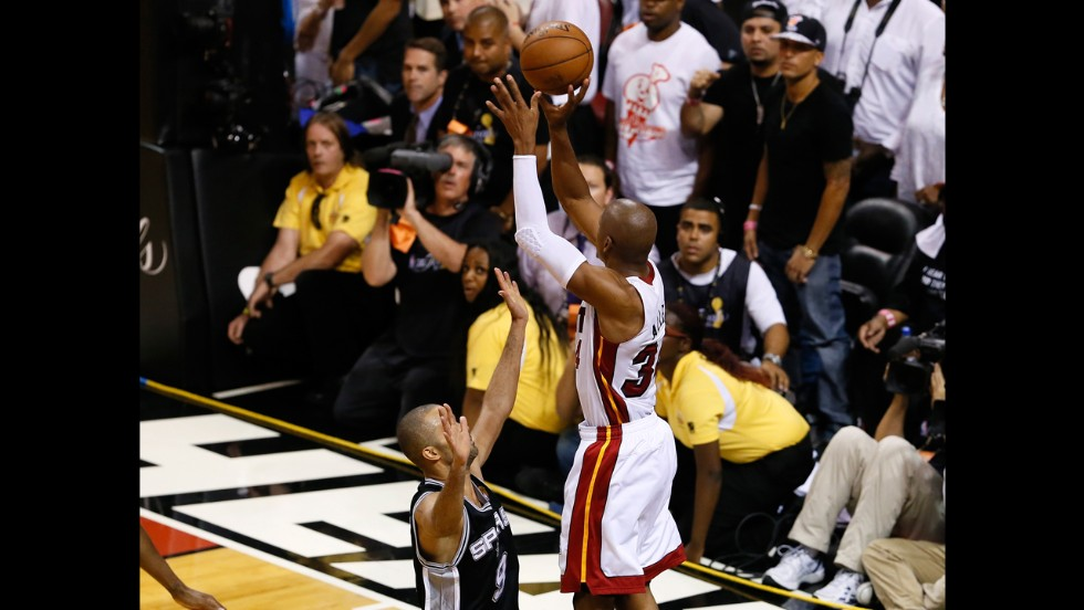 Ray Allen of the Miami Heat makes a game-tying three-pointer over Tony Parker of the San Antonio Spurs to send the game to overtime.
