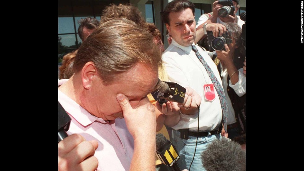 Ron Dwyer pauses to compose himself on July 20, 1996, as he speaks about his 11-year-old daughter Larkyn Lynn Dwyer, who was on TWA Flight 800.