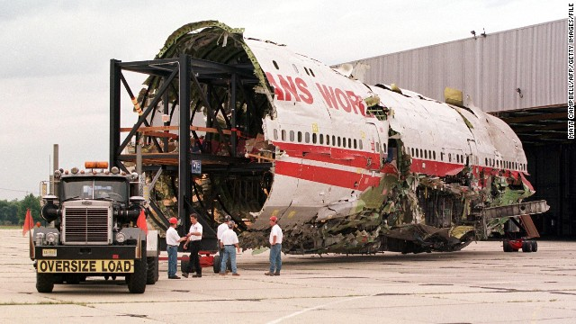The partially reconstructed fuselage of TWA Flight 800 is pulled out of a hangar in Calverton, New York on September 14, 1999.