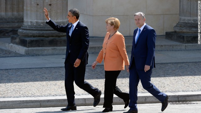 (From L) US President Barack Obama, German Chancellor Angela Merkel, Berlin Mayor Klaus Wowereit arrive at the Brandenburg Gate on June 19, 2013 in Berlin. Barack Obama walks in John F. Kennedy's footsteps this week on his first visit to Berlin as US president, but encounter a more powerful and sceptical Germany in talks on trade and secret surveillance practices.