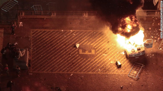 A press car burns during in front of the City Hall in Sao Paulo, on June 18.