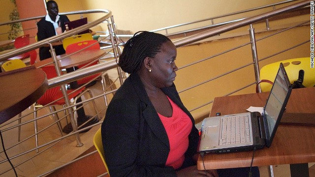 The internet can revolutionizing the lives of African women.  Pictured, a woman at an internet cafe in Kampala.