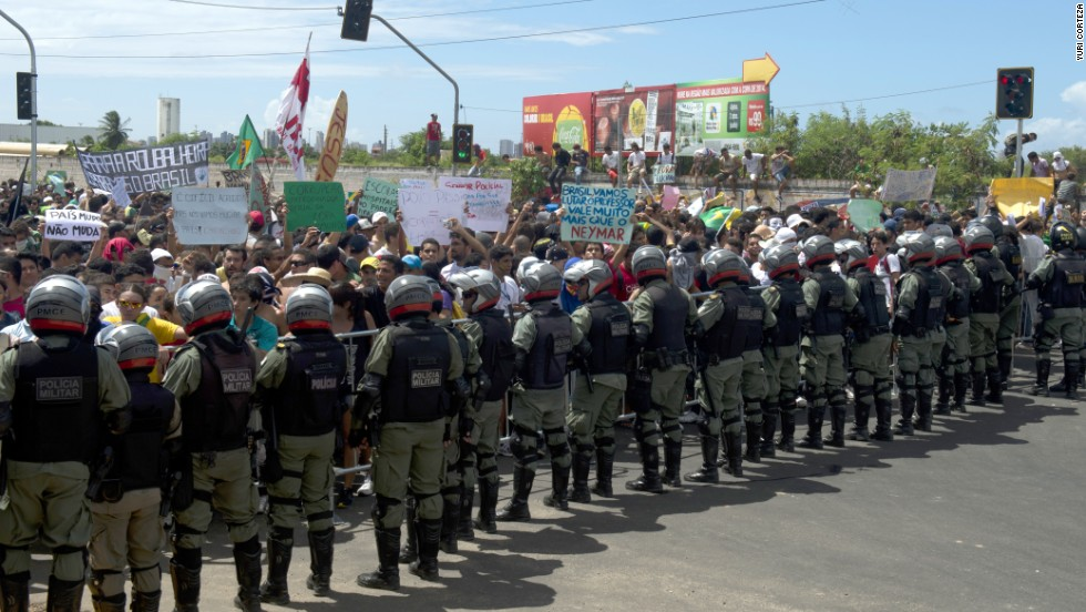 Protesters confront riot police officers on the distant outskirts of the Castelao Stadium, which has been newly built for next year's World Cup at a cost of $240 million.