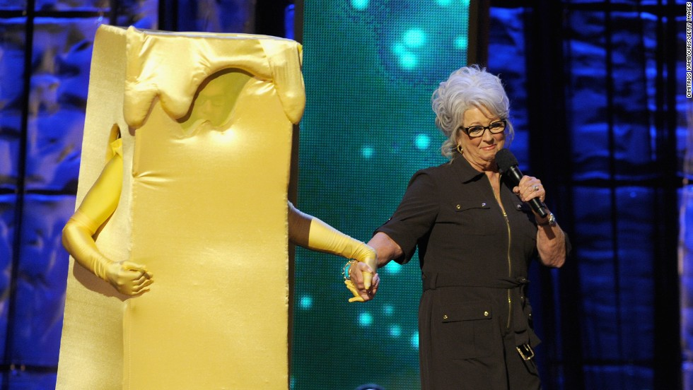 "Deen on stage with a costumed Kevin Bacon at Comedy Central's ""Night of Too Many Stars: America Comes Together for Autism Programs"" in 2012 in New York."