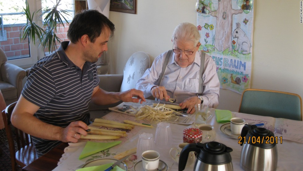 Caregiver Thomas Ganschow and resident Egon Hanss peel asparagus for dinner.